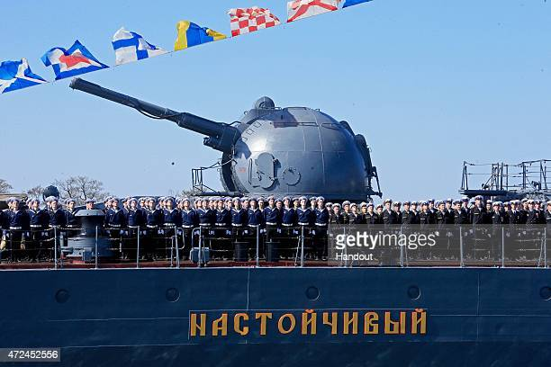 In this handout image supplied by Host photo agency / RIA Novosti The crew of the torpedo boat destroyer 'Nastoichivy' at a rehearsal of the navy...