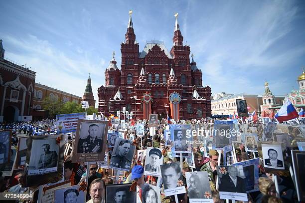 In this handout image supplied by Host photo agency / RIA Novosti Participants during the march of the Immortal Regiment Moscow regional patriotic...