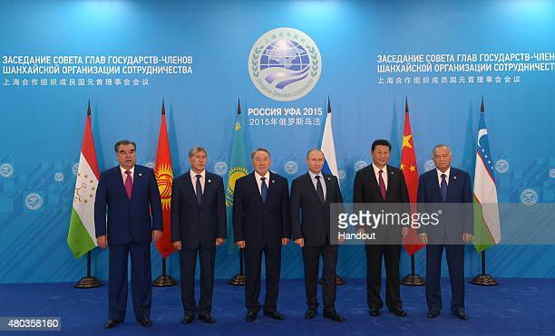 In this handout image supplied by Host Photo Agency/RIA Novosti President of the Russian Federation Vladimir Putin third left during the group...