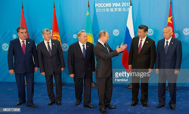 In this handout image supplied by Host Photo Agency/RIA Novosti President of the Russian Federation Vladimir Putin third right during the group...