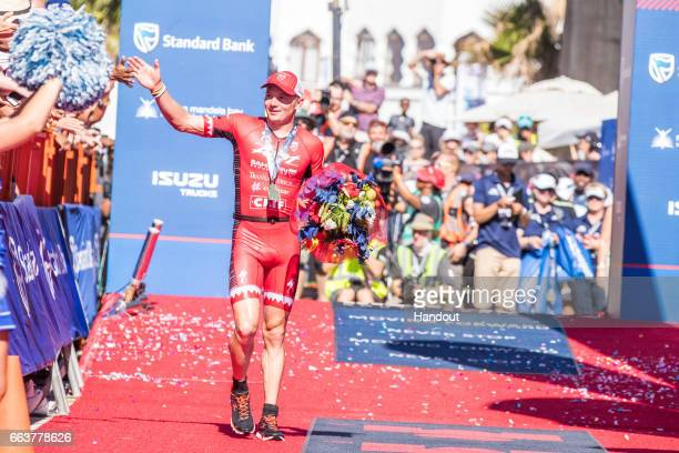 In this handout image supplied by Ironman Ben Hoffman celebrates after winning the Ironman Triathlon at Nelson Mandela Bay Port Elizabeth on April...