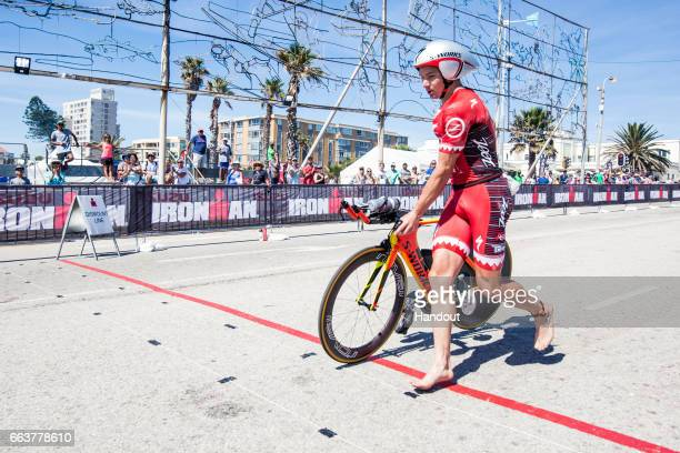 In this handout image supplied by Ironman Daniela Ryf finishes the 180km bike leg on her way to winning the Ironman Triathlon at Nelson Mandela Bay...