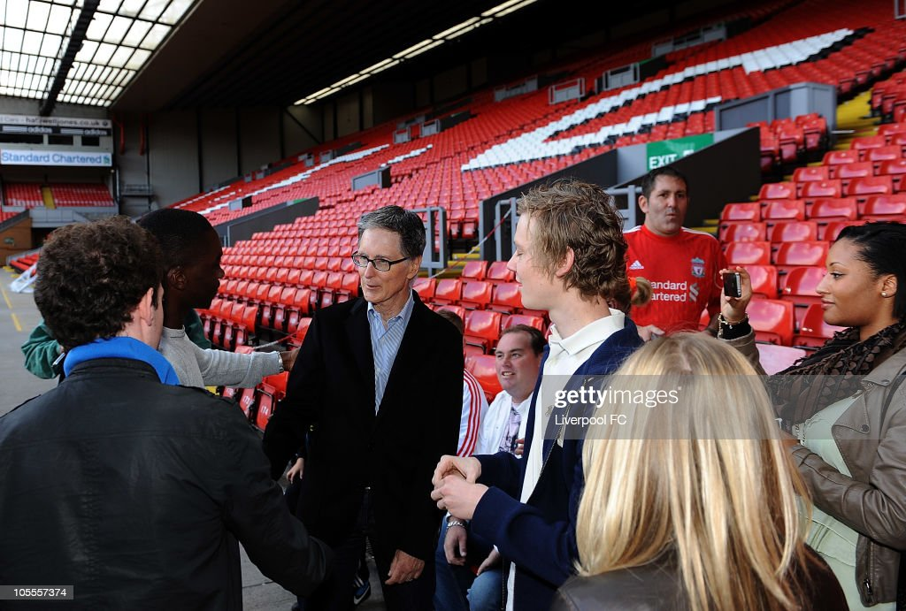In this handout image supplied by Liverpool Football Club, John W Henry of NESV meets fans on The Kop at Anfield on October 16, 2010 in Liverpool, England. Henry's New England Sports Ventures (NESV) successfully completed the £300million takeover of Liverpool following a bitter legal battle with former owners Tom Hicks and George Gillett.