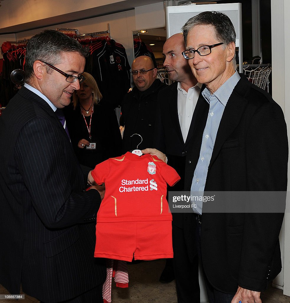 In this handout image supplied by Liverpool Football Club, John W Henry of NESV with a baby football kit in the Liverpool F.C. shop at Anfield on October 16, 2010 in Liverpool, England. Henry's New England Sports Ventures (NESV) successfully completed the £300million takeover of Liverpool following a bitter legal battle with former owners Tom Hicks and George Gillett.
