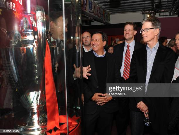 In this handout image supplied by Liverpool Football Club Thomas Werner Joe Januszewski and John W Henry look at the Champions League Trophy at the...