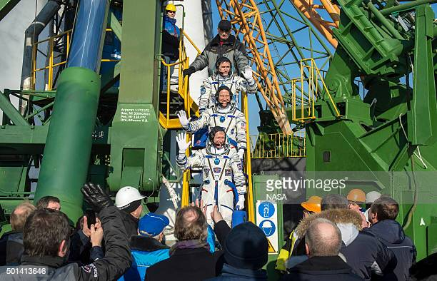 In this handout image supplied by NASA Expedition 46 Soyuz Commander Yuri Malenchenko of the Russian Federal Space Agency top Flight Engineer Tim...