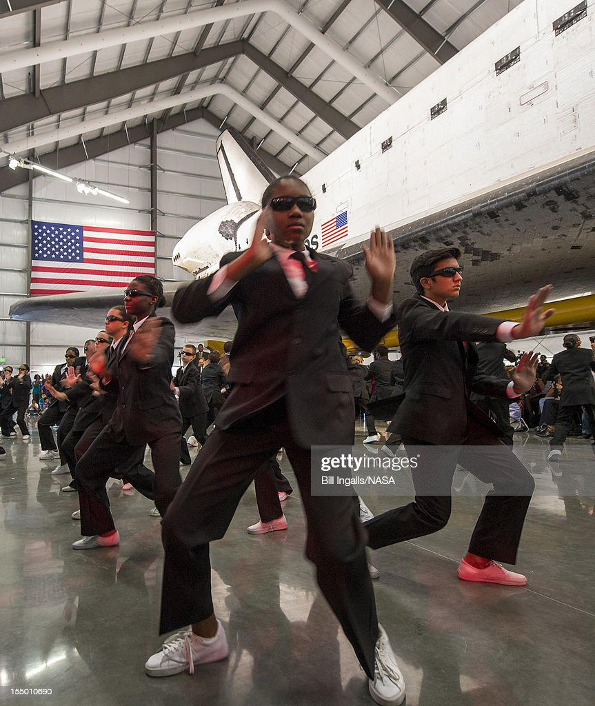 In this handout image supplied by NASA, Members of the Debbie Allen Dance Academy perform 'Men in Black' choreographed by Debbie Allen during the grand opening ceremony for the California Science center's Samuel Oschin Space Shuttle Endeavour Display Pavilion, on October 30, 2012, in Los Angeles, California. Endeavour, built as a replacement for space shuttle Challenger, completed 25 missions, spent 299 days in orbit, and orbited Earth 4,671 times while traveling 122,883,151 miles.
