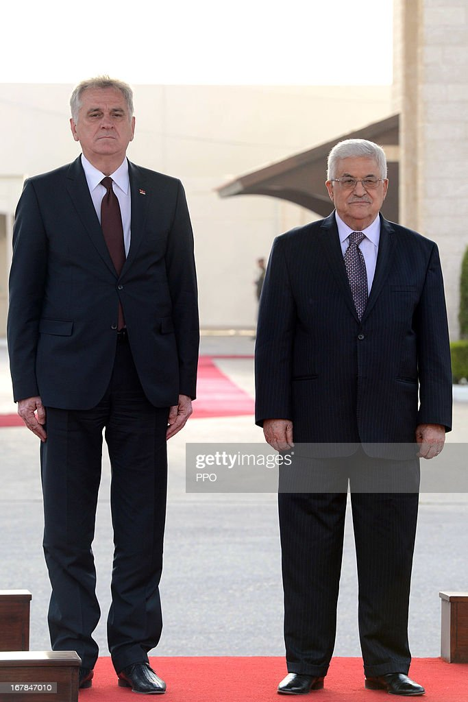 In this handout image supplied by office of the Palestinian President, President Mahmoud Abbas welcomes Serbian President <a gi-track='captionPersonalityLinkClicked' href=/galleries/search?phrase=Tomislav+Nikolic&family=editorial&specificpeople=801987 ng-click='$event.stopPropagation()'>Tomislav Nikolic</a> on May 1, 2013 in Ramallah, West Bank.