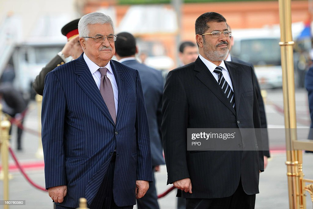 In this handout image supplied by PPO, Palestinian President Mahmoud Abbas attends an official reception with Egyptian President Mohamed Morsi, on February 5, 2013 in Cairo, Egypt. Protests have continued across Egypt nearly more than one week after the second anniversary of the Egyptian Revolution that overthrew former President Hosni Mubarak.