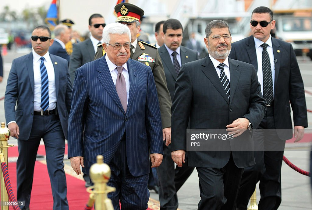 In this handout image supplied by PPO, Palestinian President Mahmoud Abbas attends an official reception with Egyptian President <a gi-track='captionPersonalityLinkClicked' href=/galleries/search?phrase=Mohamed+Morsi&family=editorial&specificpeople=7484676 ng-click='$event.stopPropagation()'>Mohamed Morsi</a>, on February 5, 2013 in Cairo, Egypt. Protests have continued across Egypt nearly more than one week after the second anniversary of the Egyptian Revolution that overthrew former President Hosni Mubarak.