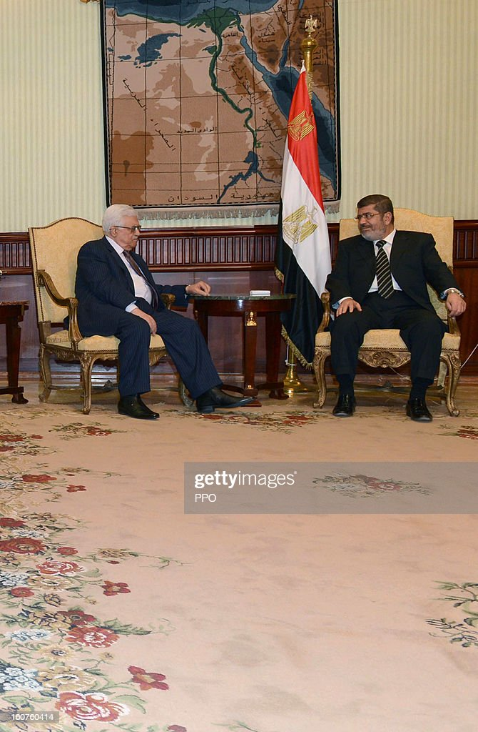 In this handout image supplied by PPO, Palestinian President Mahmoud Abbas attends a meeting with Egyptian President <a gi-track='captionPersonalityLinkClicked' href=/galleries/search?phrase=Mohamed+Morsi&family=editorial&specificpeople=7484676 ng-click='$event.stopPropagation()'>Mohamed Morsi</a>, on February 5, 2013 in Cairo, Egypt. Protests have continued across Egypt nearly more than one week after the second anniversary of the Egyptian Revolution that overthrew former President Hosni Mubarak.