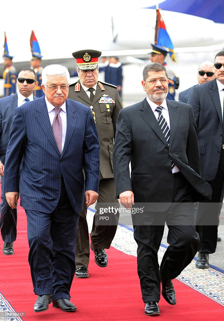 In this handout image supplied by PPO, Palestinian President <a gi-track='captionPersonalityLinkClicked' href=/galleries/search?phrase=Mahmoud+Abbas&family=editorial&specificpeople=176534 ng-click='$event.stopPropagation()'>Mahmoud Abbas</a> attends an official reception with Egyptian President <a gi-track='captionPersonalityLinkClicked' href=/galleries/search?phrase=Mohamed+Morsi&family=editorial&specificpeople=7484676 ng-click='$event.stopPropagation()'>Mohamed Morsi</a>, on February 5, 2013 in Cairo, Egypt. Protests have continued across Egypt nearly more than one week after the second anniversary of the Egyptian Revolution that overthrew former President Hosni Mubarak.