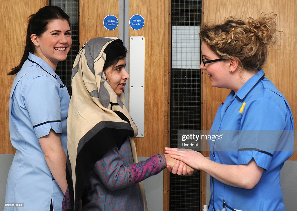 In this handout image supplied by Queen Elizabeth Hospital on January 04, 2013 <a gi-track='captionPersonalityLinkClicked' href=/galleries/search?phrase=Malala+Yousafzai&family=editorial&specificpeople=5849423 ng-click='$event.stopPropagation()'>Malala Yousafzai</a> says goodbye to nurses as she leaves the Queen Elizabeth Hospital in Birmingham, United Kingdom. The Pakistani schoolgirl activist who was shot in the head by Taliban gunmen has been discharged today from Queen Elizabeth Hospital in Birmingham as an inpatient.