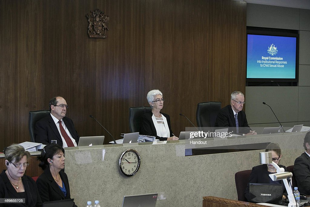 In this handout image supplied by Royal Commission Media, Justice Jennifer Coate, Commissioner Andrew Murray and Commissioner Bob Atkinson with Senior Counsel representing the Royal Commission Gail Furness preside over the first day of the Royal Commission public hearing into Institutional Responses to Child Sexual Abuse on February 17, 2014 in Brisbane, Australia.