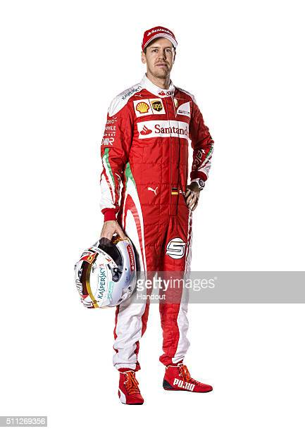 In this handout image supplied by Scuderia Ferrari driver Sebastian Vettel of Germany poses in the team's new overalls for the 2016 FIA Formula One...