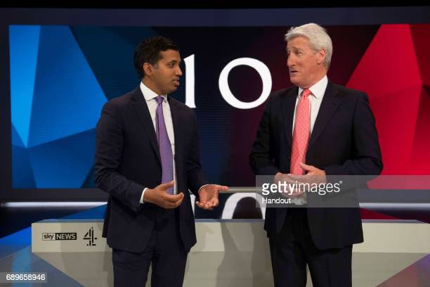 In this handout image supplied by Sky Sky News' Political Editor Faisal Islam and Channel 4's Jeremy Paxman rehearse on set ahead of the live...