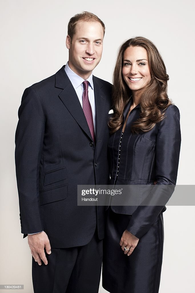 In this handout image supplied by St James's Palace, Prince William, Duke of Cambridge and Catherine, Duchess of Cambridge pose for the official tour portrait for their trip to Canada and California in the Garden's of Clarence House on June 3, 2011 in London. England. This image has been released on October 26, 2011 to coincide with the Royal couple's visit to UNICEF next week in Copenhagen.