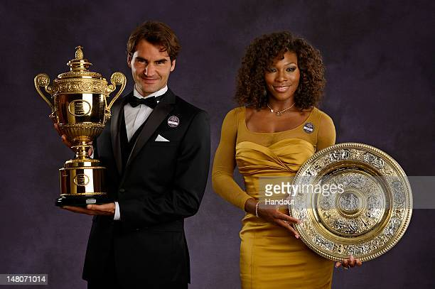 In this handout image supplied by the All England Lawn Tennis Club Wimbledon Singles Champions Serena Williams of the USA and Roger Federer of...