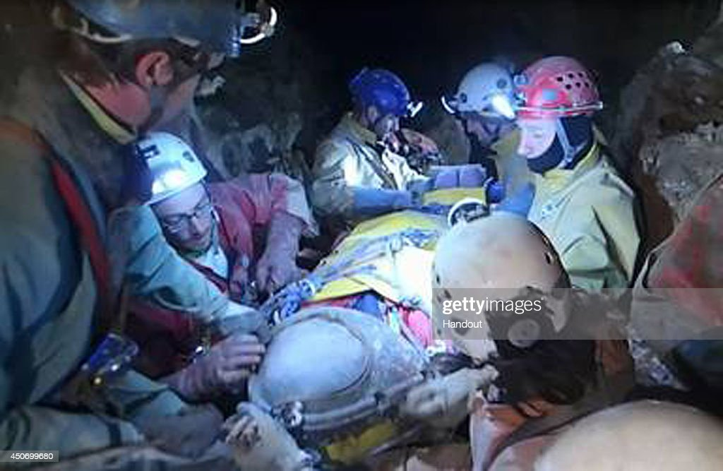 In this handout image supplied by the Bavarian mountain patrol 'Bergwacht Bayern', Rescue workers transport injured spelunker Johann Westhauser from 700 meters underground towards the surface of the Riesending cave on June 16, 2014 near Marktschellenberg, Germany. Westhauser, along with two colleagues, was exploring the Riesending vertical cave, which is over 20km long and up to 1,148 meters deep, when he was struck by rocks and severely injured 1,000 meters underground on June 8. Since then specialist rescue workers from across Europe are helping with the arduous rescue effort, which will likely take at least several more days.