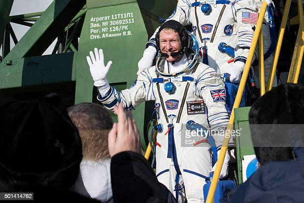 In this handout image supplied by the European Space Agency Expedition 46 Soyuz Flight Engineer Tim Peake of ESA waves farewell prior to boarding the...