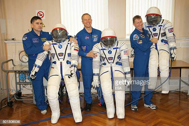 In this handout image supplied by the European Space Agency Expedition 46/47 Roscosmos commander Yuri Malenchenko NASA astronaut Tim Kopra and ESA...
