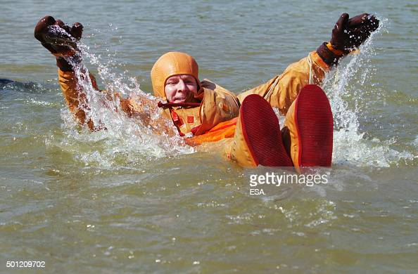 In this handout image supplied by the European Space Agency ESA astronaut Timothy Peake takes part in a water survival training session on July 1...