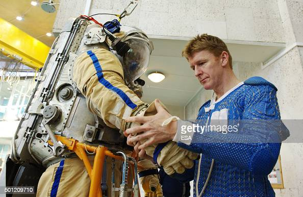 In this handout image supplied by the European Space Agency ESA astronaut Tim Peake inspecting a Russian Orlan suit during training at the Gagarin...
