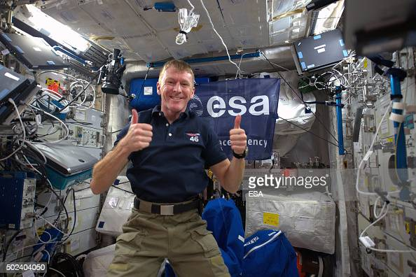 In this handout image supplied by the European Space Agency ESA astronaut Tim Peake gives the thumbs up in zero gravity days after his arrival on the...