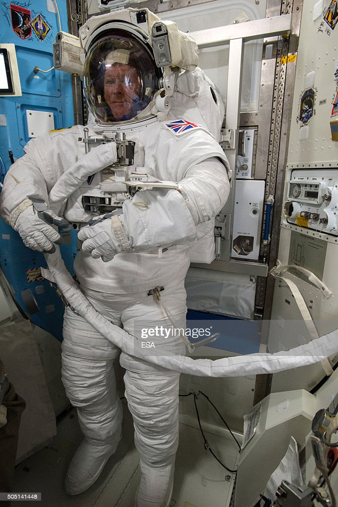 In this handout image supplied by the European Space Agency (ESA), ESA astronaut Tim Peake looks on during the final fit check of his spacesuit ahead of the International Space Station spacewalk scheduled for tomorrow on January 14, 2016. Astronaut Tim Peake will venture outside of the International Space Station together with NASA astronaut Timothy Kopra to replace a failed voltage regulator to return power to one of eight power channels. The spacewalk is expected to last 6.5 hours.