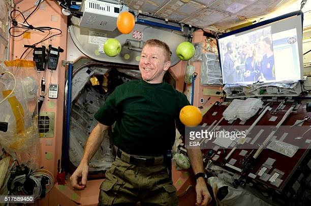 In this handout image supplied by the European Space Agency ESA astronaut Tim Peake receives fresh fruit with the arrival of the Soyuz 46S crew on...