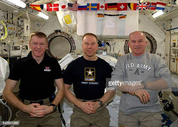 In this handout image supplied by the European Space Agency ESA astronaut Tim Peake poses with NASA's Tim Kopra and Jeff Williams on June 11 2016
