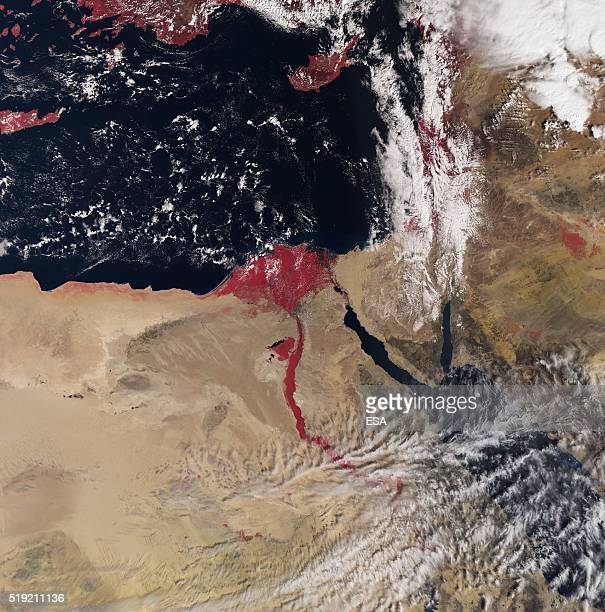 In this handout image supplied by the European Space Agency The new Sentinel3A satellite in orbit records the sites over the River Nile flowing red...
