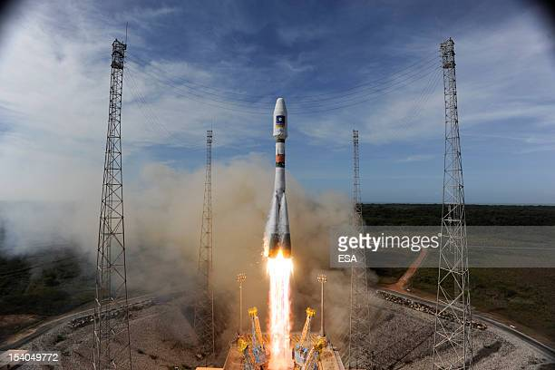 In this handout image supplied by the European Space Agency the Soyuz rocket lifts off for the third time from Europe's Spaceport in French Guiana on...