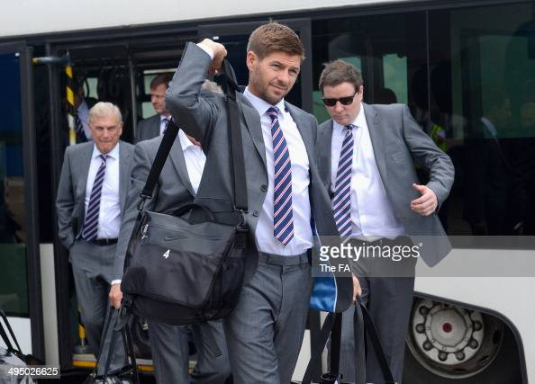 In this handout image supplied by the FA captain Steven Gerrard of England prepares to board a plane leaving for the 2014 Brazil World Cup on June 1...