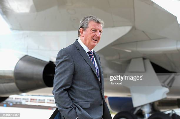In this handout image supplied by the FA England manager Roy Hodgson prepares to board a plane leaving for the 2014 Brazil World Cup on June 1 2014...