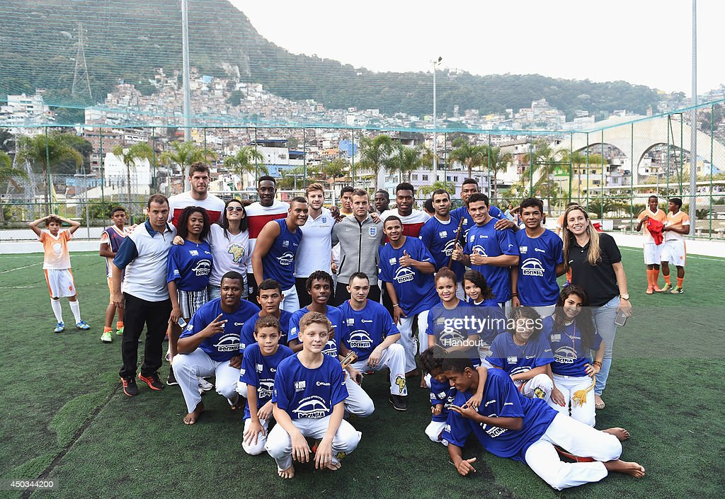 In this handout image supplied by the FA Fraser Forster Danny Welbeck Adam Lallana Jack Wilshere and Daniel Sturridge pose for a photo with a group...