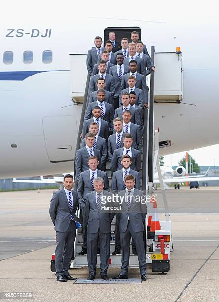 In this handout image supplied by the FA the England squad prepare to board a plane leaving for the 2014 Brazil World Cup on June 1 2014 in Luton...