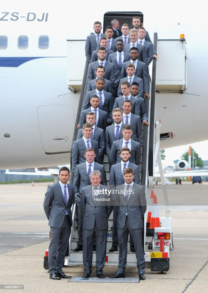 In this handout image supplied by the FA, the England squad prepare to board a plane leaving for the 2014 Brazil World Cup on June 1, 2014 in Luton, England.