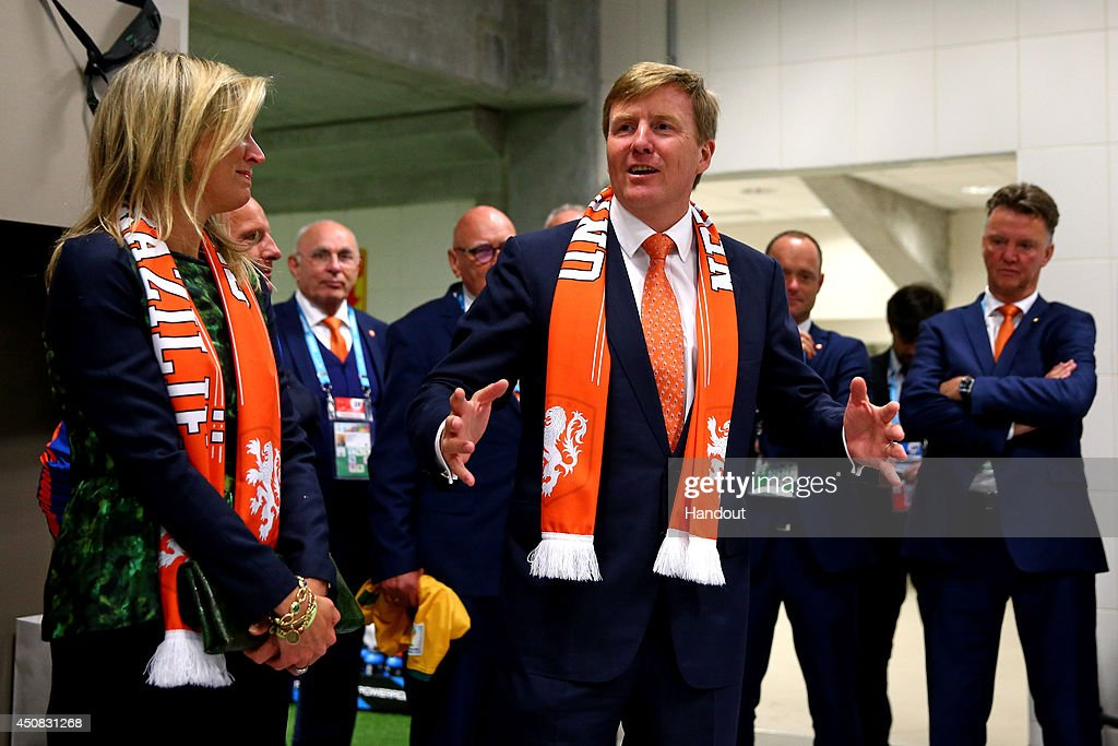 In this handout image supplied by the FIFA, King Willem-Alexander of the Netherlands and Queen Maxima of the Netherlands celebrate with the Netherlands team after the 2014 FIFA World Cup Brazil Group B match between Australia and Netherlands at Estadio Beira-Rio on June 18, 2014 in Porto Alegre, Brazil.