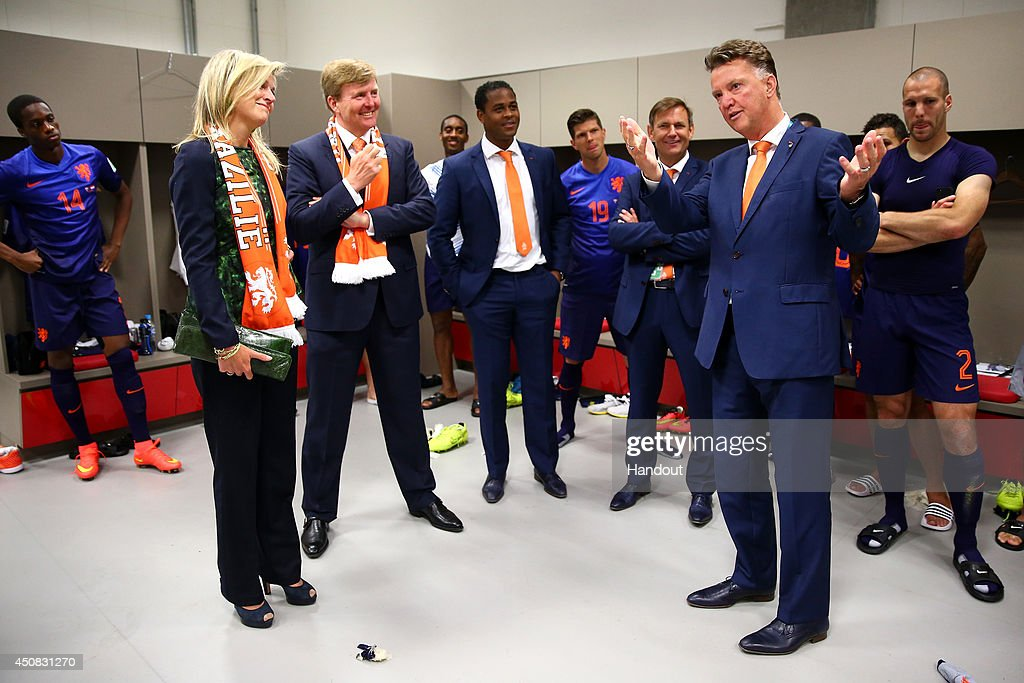 In this handout image supplied by the FIFA, King Willem-Alexander of the Netherlands and Queen Maxima of the Netherlands celebrate with coach Louis van Gaal of the Netherlands after the 2014 FIFA World Cup Brazil Group B match between Australia and Netherlands at Estadio Beira-Rio on June 18, 2014 in Porto Alegre, Brazil.