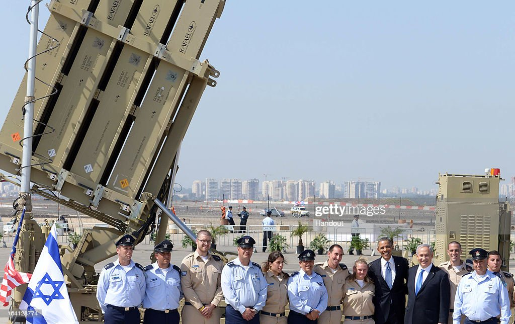 In this handout image supplied by the Government Press Office of Israel (GPO), US President Barack Obama (7th R) and Israeli President Benjamin Nethanyahu pose with members of the military in front of a missile launcher, at Ben Gurion International Airport on March 20, 2013 near Tel Aviv, Israel. This will be Obama's first visit as President to the region, and his itinerary will include meetings with the Palestinian and Israeli leaders as well as a visit to the Church of the Nativity in Bethlehem.