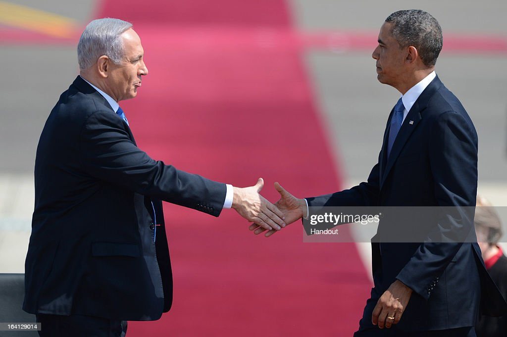 In this handout image supplied by the Government Press Office of Israel (GPO), US President Barack Obama is welcomed by Israeli President Benjamin Nethanyahu at Ben Gurion International Airport on March 20, 2013 near Tel Aviv, Israel. This will be Obama's first visit as President to the region, and his itinerary will include meetings with the Palestinian and Israeli leaders as well as a visit to the Church of the Nativity in Bethlehem.