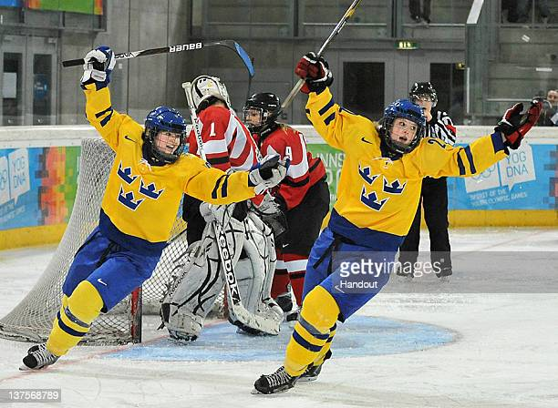 In this handout image supplied by the International Olympic Committee Women's Ice Hockey Gold Medal Final Swedens Maria Fuhrberg and Johanna...