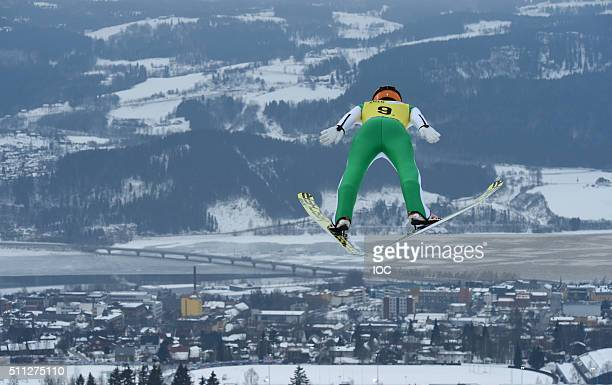 In this handout image supplied by the IOC Clemens Leitner of Austria competes in the Nordic Mixed Team NH/3x33km Ski Jumping at Lysgardsbakkene Ski...