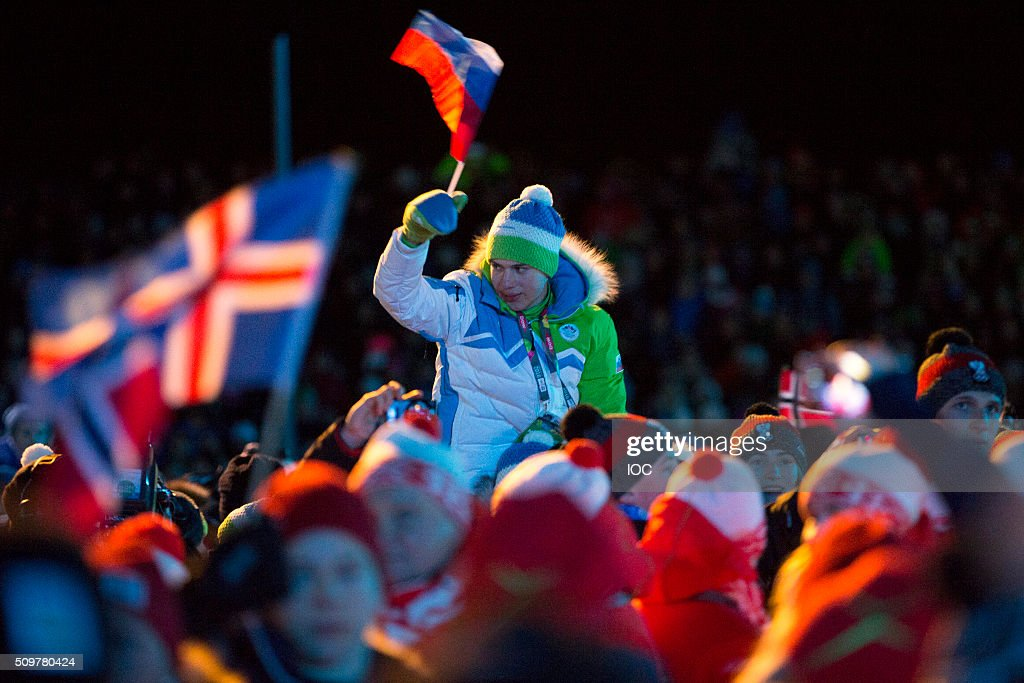 In this handout image supplied by the IOC, Fans wave flags during the Opening Ceremony of the Lillehammer 2016 Winter Youth Olympic Games at the Lysgardsbakkene Ski Jumping Arena on February 12, 2016 in Lillehammer, Norway.