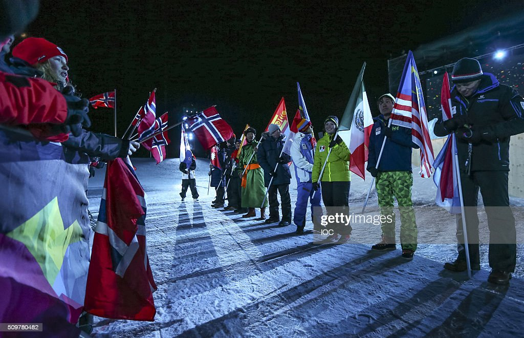 http://media.gettyimages.com/photos/in-this-handout-image-supplied-by-the-ioc-flagbearers-during-the-of-picture-id509780482