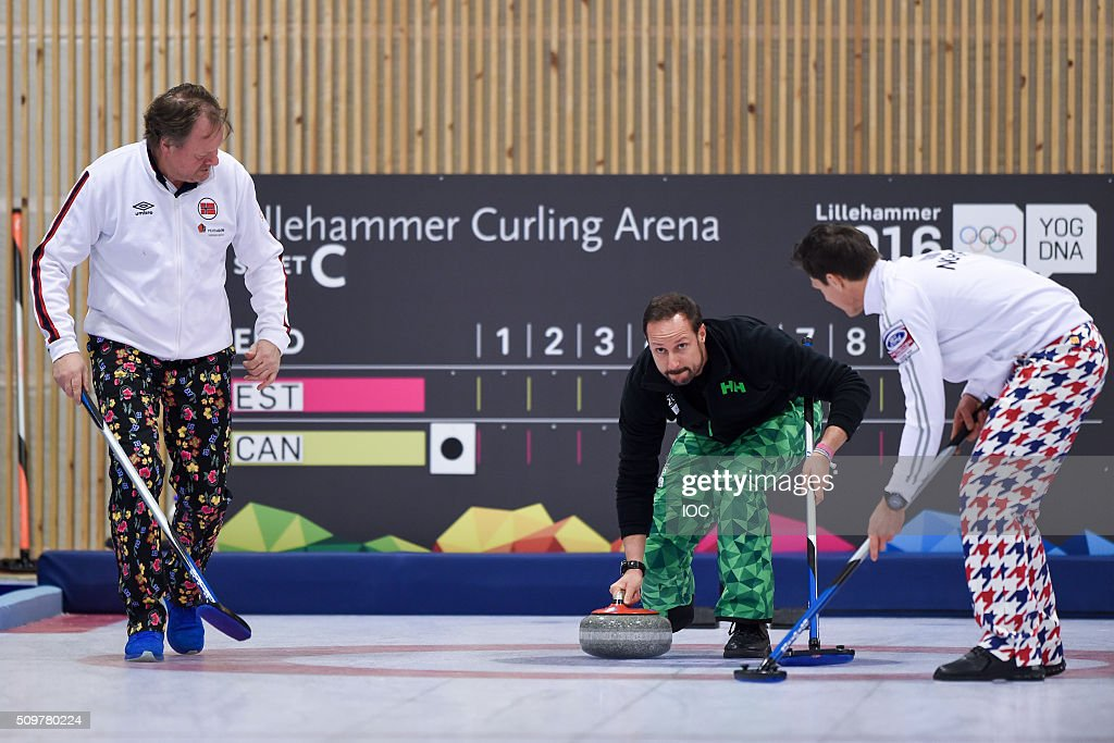 In this handout image supplied by the IOC, Haakon, Crown Prince of Norway pushes the first Curling Stone with Pal Trulsen (Left) 2002 Curling Olympic Gold Medalist and <a gi-track='captionPersonalityLinkClicked' href=/galleries/search?phrase=Thomas+Ulsrud&family=editorial&specificpeople=4691232 ng-click='$event.stopPropagation()'>Thomas Ulsrud</a> (Right) Norwegian Men's Curling Captain at The Kristins Hall at the Winter Youth Olympic Games on February 12, 2016 in Lillehammer, Norway.
