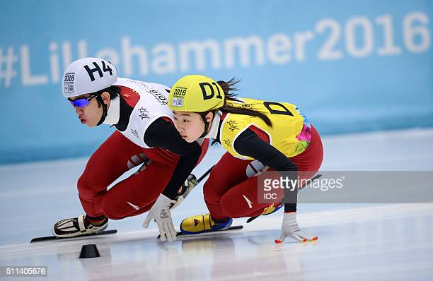 In this handout image supplied by the IOC Ma Wei of China and Gong Li of China compete in the Short Track Speed Skating Mixed NOC Team Relay...