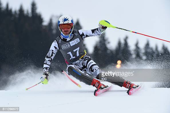 In this handout image supplied by the IOC Manuel Traning of Austria on his way to wining the Gold Medal in the Alpine Skiing Men's Slalom at the...