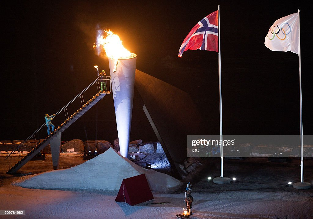 In this handout image supplied by the IOC, The Norwegian Flag and the Olympic Flag fly over Lysgrdsbakkene Ski Jumping Arena as the flame of the Lillehammer 2016 Winter Youth Olympic Games gets delivered to the cauldron by Her Royal Highness <a gi-track='captionPersonalityLinkClicked' href=/galleries/search?phrase=Princess+Ingrid+Alexandra&family=editorial&specificpeople=243087 ng-click='$event.stopPropagation()'>Princess Ingrid Alexandra</a> of Norway during the Opening Ceremony of the Lillehammer 2016 Winter Youth Olympic Games on February 12, 2016 in Lillehammer, Norway.